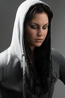 Young woman wearing hooded top