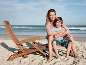 Mother and son on lounge chair (thumbnail)