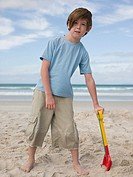 Boy on beach with spade (thumbnail)