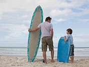 Father and son with surfboard and bodyboard