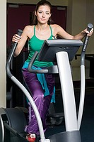 Woman on cross trainer