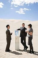 People around water cooler in the desert
