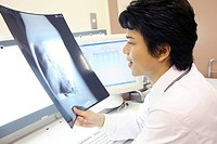 Doctor looking at X_ray