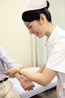 Nurse measuring a pulse (thumbnail)