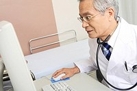 Physician operating a PC