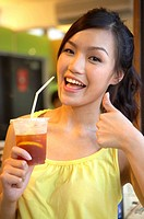 Young Lady Holding Cold Drink