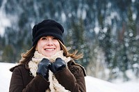 Smiling woman bundled up