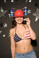 Young woman wearing hard hat, smiling, portrait