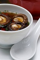 Close_up of Chinese soup with mushrooms in a bowl