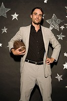 Businessman holding football ball, portrait