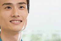 Close_up of a male office worker smiling