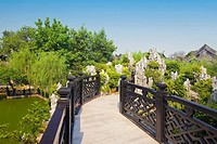 Footbridge over a pond, Yu Yin Shan Fang, Panyu, Guangzhou, Guangdong Province, China