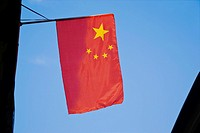 Low angle view of a Chinese flag, Tunxi Old Street, Anhui Province, China