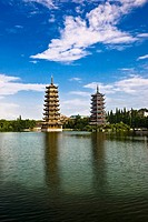 Pagodas at lakeside, Sun And Moon Pagoda, Banyan Lake, Guilin, Guangxi Province, China