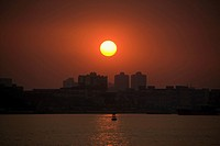 Sunset over a city, Shamian Island, Guangzhou, Guangdong Province, China