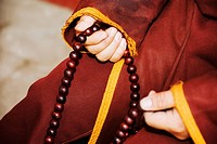 Mid section view of a person's hand holding a prayer beads, Da Zhao Temple, Hohhot, Inner Mongolia, China