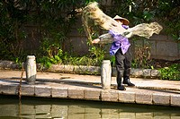 Fisherman throwing a fishing net in a lake, Guilin, Guangxi Province, China