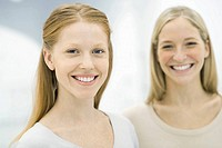 Two women smiling at camera, portrait