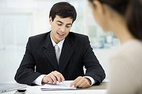 Businessman explaining document to client