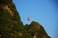 Low angle view of a hot air balloon, Yangshuo, Guangxi Province, China (thumbnail)