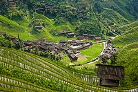 High angle view of a village in a hill range, Jinkeng Terraced Field, Guangxi Province, China