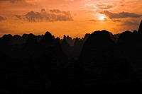Silhouette of hill ranges at dusk, Guilin Hills, Xingping, Yangshuo, Guangxi Province, China