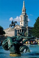 England _ London _ St James's district _ sculpture and fountain at Trafalgar Square with Church of St Martin in background