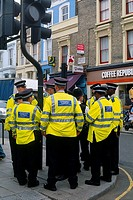 England _ London _ Notting Hill district _ Metropolitan polices standing by traffic signal