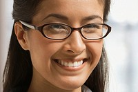 Asian woman in eyeglasses smiling