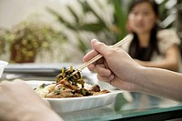 Close_up of a person´s hand holding chopsticks