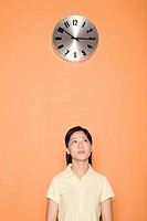 Female office worker with a clock above her head