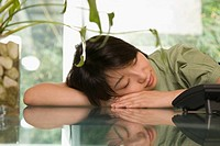 Female office worker napping at a table