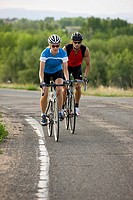 Two cyclists on country road