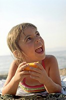 Happy, young girl on the beach