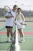 Senior Asian couple and tennis