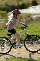 Girl 8_9 cycling in countryside