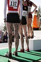 Athletes covered in mud