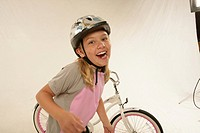Studio portrait of girl 6_7 in front of bicycle