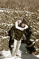 Young couple in forest in winter