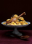 Couscous with goose confit and quinces