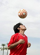 Soccer player heading ball portrait