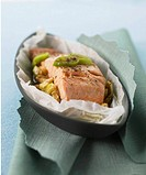 Salmon with leeks and soy sauce in parchment paper