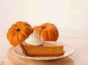 A Slice of Pumpkin Pie with Mini Pumpkins