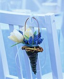 Posy of tulips and grape hyacinths in a wicker basket
