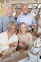 Middle_aged Friends drinking champagne and Celebrating Together