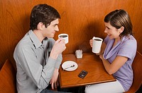 High angle view of a young couple having coffee in a cafe