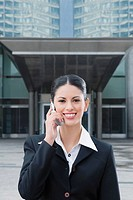 Portrait of a businesswoman talking on a mobile phone and smiling