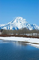 Lake with a snow covered mountain in the background, Grand Teton National Park, Wyoming, USA
