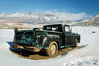 An old clasic truck abanon in the winter snow, Shell, Wyoming, USA