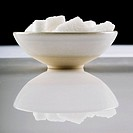 Close_up of a bowl of sugar cubes